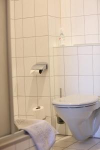 Ein Badezimmer in der Unterkunft Pension Sachsenallee