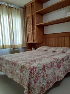 A bed or beds in a room at Gallardin Palace Hotel