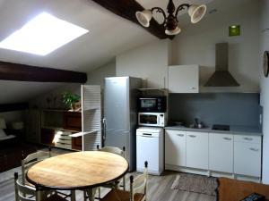 Cuisine ou kitchenette dans l'établissement Les Terrasses de Saillans