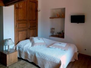 Un ou plusieurs lits dans un hébergement de l'établissement Les Terrasses de Saillans