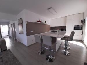 A kitchen or kitchenette at VILLA MARETA BEACH