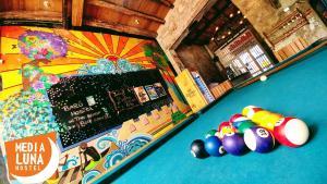A pool table at Media Luna Hostel Cartagena