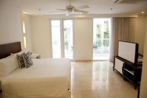 A bed or beds in a room at Nacar Hotel Cartagena, Curio Collection by Hilton