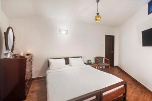 A bed or beds in a room at Villa Retreat - Boutique Hotel