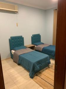 Cama ou camas em um quarto em الوفاء 1