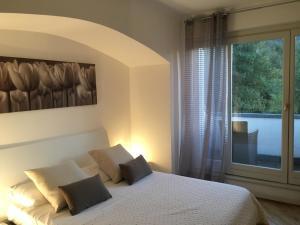 Een bed of bedden in een kamer bij Villa Viola