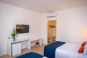 A bed or beds in a room at SUN CITY ROTA DAS EMOÇÕES BY NOBILE
