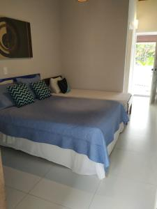 A bed or beds in a room at Paúba Beach Hotel