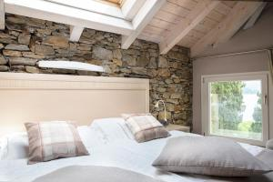 A bed or beds in a room at Relais Villa Porta
