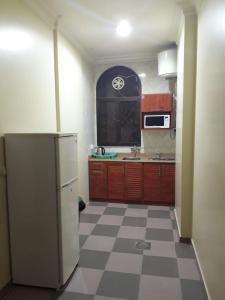 A cozinha ou cozinha compacta de المقصورة 1 للأجنحة الفندقية