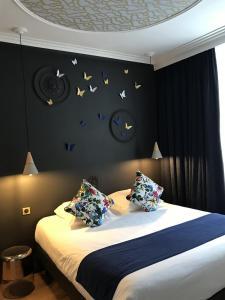 Un ou plusieurs lits dans un hébergement de l'établissement Le Grand Hôtel