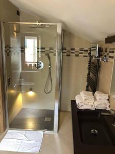 Ванная комната в Hotel Berlinghera