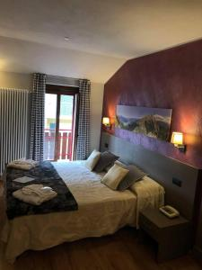 Кровать или кровати в номере Hotel Berlinghera