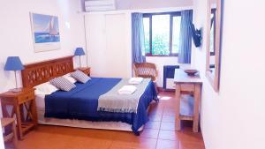 Una cama o camas en una habitación de El Cortijo