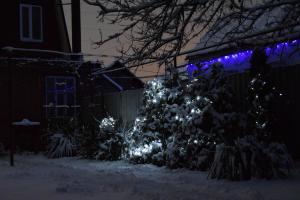 Коттедж с кухней и летней террасой зимой