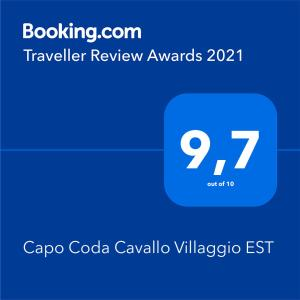 A certificate, award, sign, or other document on display at Capo Coda Cavallo Villaggio EST