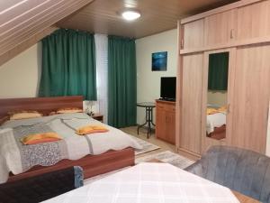 Postel nebo postele na pokoji v ubytování Ilona Ház