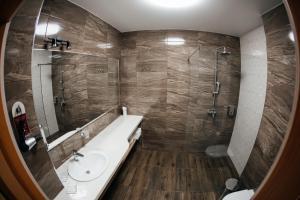 Ванная комната в Клубный Отель Прионежский