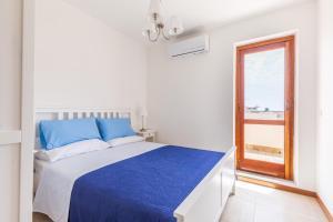 Letto o letti in una camera di Mondello Sabrina Apartments