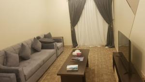 Uma área de estar em Arabian Palm Hotel