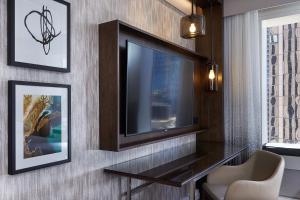 Hilton Sydney tesisinde bir televizyon ve/veya eğlence merkezi