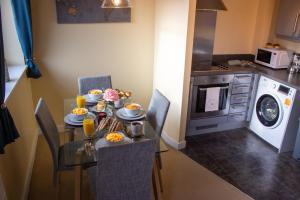 A kitchen or kitchenette at Broad Gauge Suite