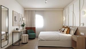 Een bed of bedden in een kamer bij HD Parque Cristobal Gran Canaria