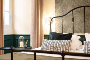 Un ou plusieurs lits dans un hébergement de l'établissement Les Suites de Sautet