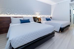 A bed or beds in a room at Quality Saint Paul Rio Preto