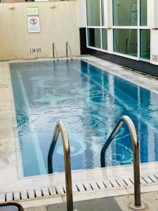 The swimming pool at or near Holiday Inn Meydan, an IHG Hotel