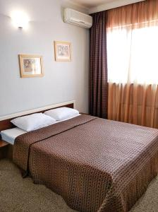 Кровать или кровати в номере Hotel Tet-a-Tet
