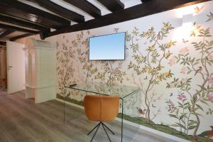 A television and/or entertainment center at Villa Delange