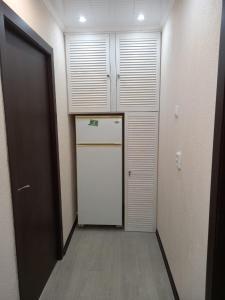 Кухня или мини-кухня в Apartment on Lenina 55