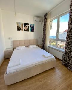 Кровать или кровати в номере Апартаменты на Парусной 19