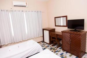 A television and/or entertainment center at Hotel Presidente