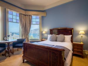A bed or beds in a room at Grande Vue Private Hotel