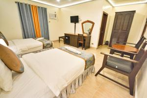 A bed or beds in a room at Royal Park Resort Boracay