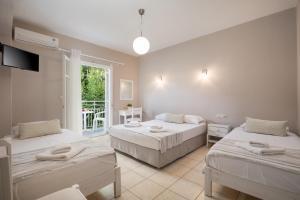 Ένα ή περισσότερα κρεβάτια σε δωμάτιο στο Bella Studios
