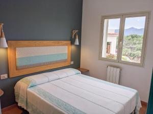 A bed or beds in a room at Residence Hotel Lu Nibareddu