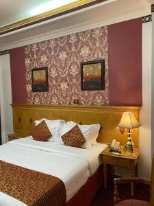 Cama ou camas em um quarto em فندق المروج كريم AlMorooj Kareem Hotel