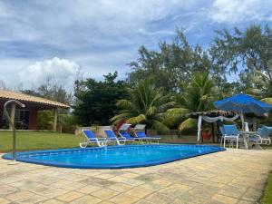 The swimming pool at or close to Casa Vermelha