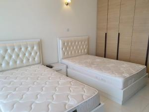 A bed or beds in a room at Ap01 European Luxury Tecom