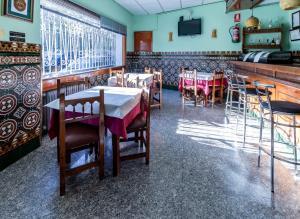 Restaurant ou autre lieu de restauration dans l'établissement Casa de Huespedes Carabanchel by Vivere Stays