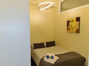 A bed or beds in a room at The Avenue