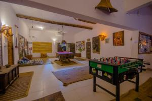 A pool table at Distant Relatives Ecolodge & Backpackers