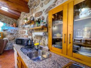 Cuisine ou kitchenette dans l'établissement Refúgio do Óscar