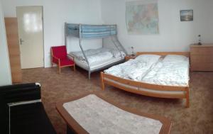 Кровать или кровати в номере Privát Saxán