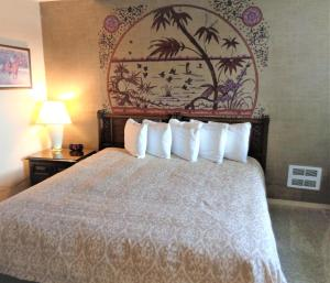 A bed or beds in a room at The Polynesian Resort