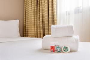 Cama ou camas em um quarto em Meliá Campinas