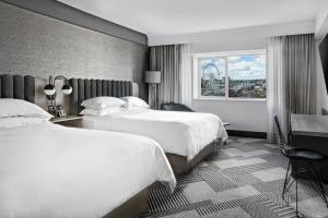A bed or beds in a room at Sheraton Fallsview Hotel